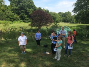 Julie Slavet and Rosanne Mistretta show Jenkintown Creek headwaters buffer at Abington Friends School.