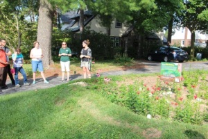 Ms. Mittleman and PRC representatives describe rain garden campaign.