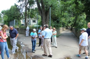 Tour group visits channelized section of Sandy Run, Abington Township